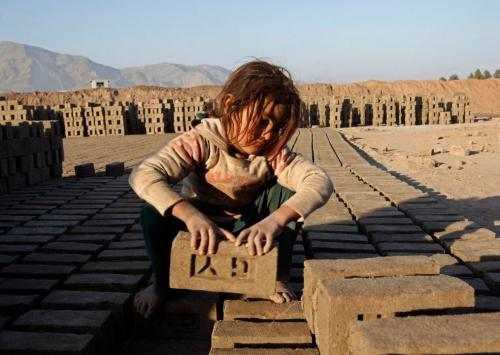 An Afghan girl works at a brick-making factory in Nangarhar province, Afghanistan on January 6, 2015. (REUTERS/Parwiz)
